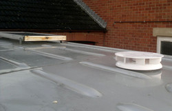 The roof vent and solar panel.