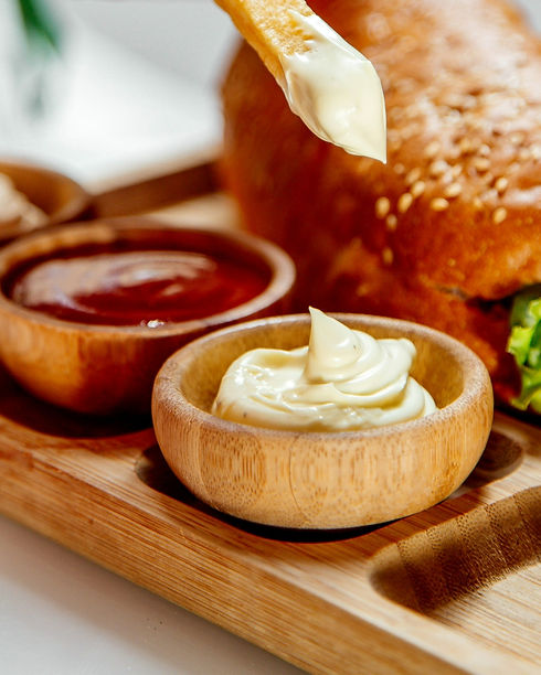 woman-dips-fries-into-mayonnaise_edited_edited.jpg