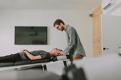 illumINNATE male chiropractor, Francisco Turelli, adjusting a male patient.
