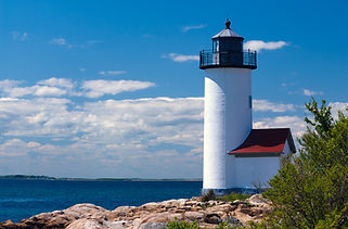 Annisquam Lighthouse on rocky shoreline