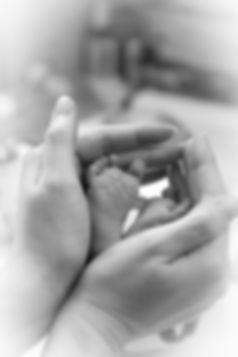 Canva - Hand Holding Feet of Baby.jpg