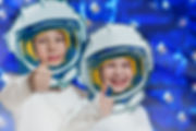 Portrait of two smiling kids in space su