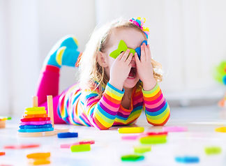 Child playing with wooden toys at presch