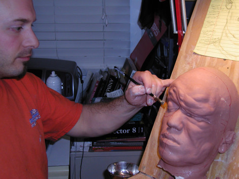 Kelman sculpting the deformed character from REST STOP (2006)