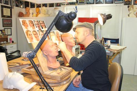 Kelman sculpts a test makeup on actress Jennifer Lawrence for JOY (2015)