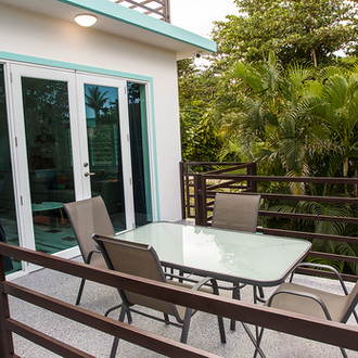 Large balcony at the Happy Turtle loft, surrounded by lush tropical forest