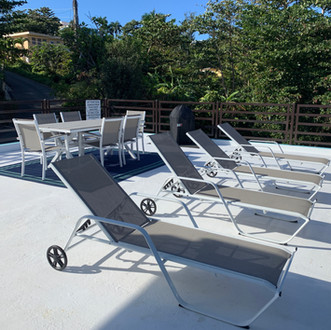 Rooftop deck with ocean views is complete with loungers, a table and chairs and a bbq area