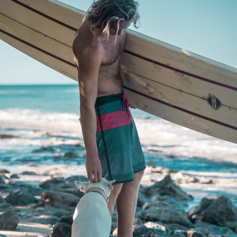 Surfer and his dog at Sandy Beach