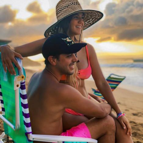 A couple enjoyin gthe sunset at Sany Beach