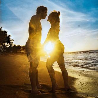 A couple enjoying the sunset at Sandy Beach
