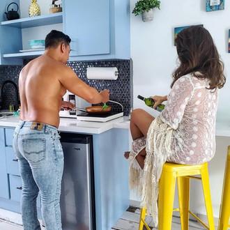 A couple enjoying the kitchenette in the Ocean loft