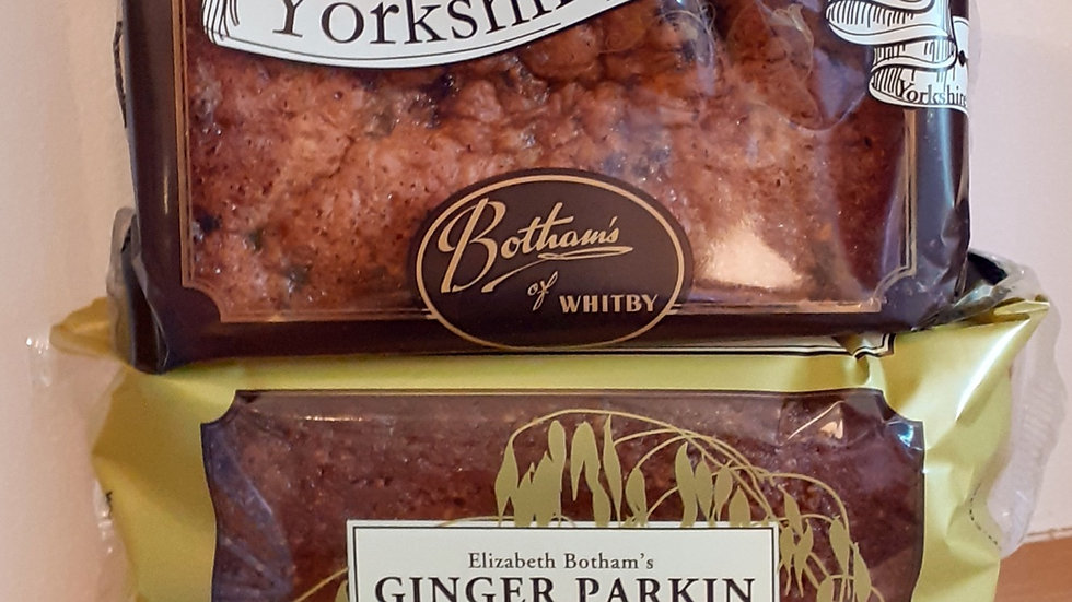 2 traditional yorkshire cakes in plastic packets on a wooden shelf