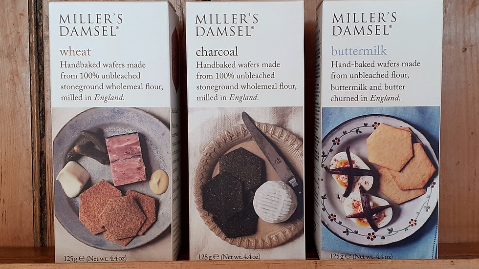 Miller's Damsel crackers for cheese in cardboard boxes on a wooden shelf