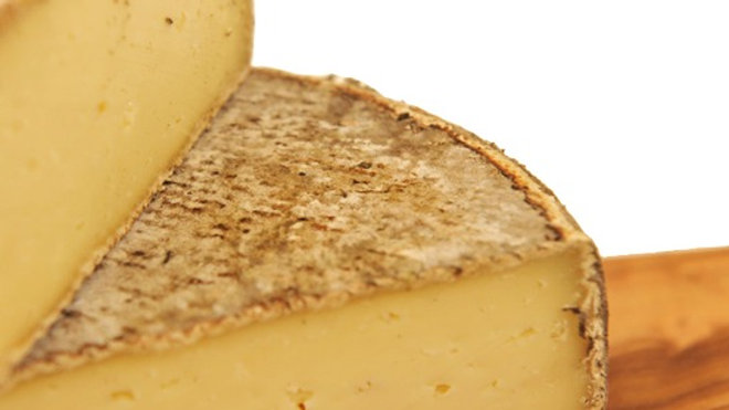 French Tomme Cheese Small Round yellow Cheese Brown Rustic Rind Savoie Savoy
