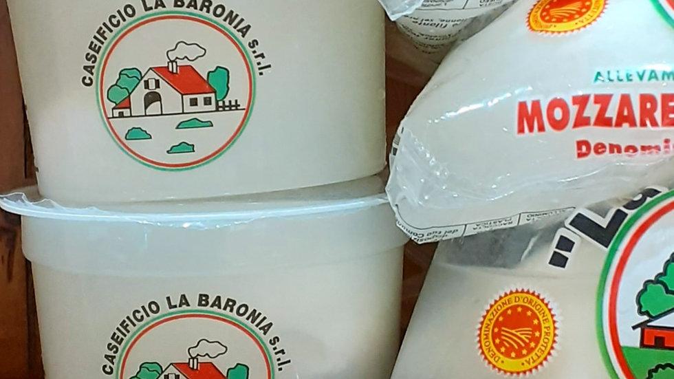 burrata in plastic tubs burrata di bufala on a wooden shelf