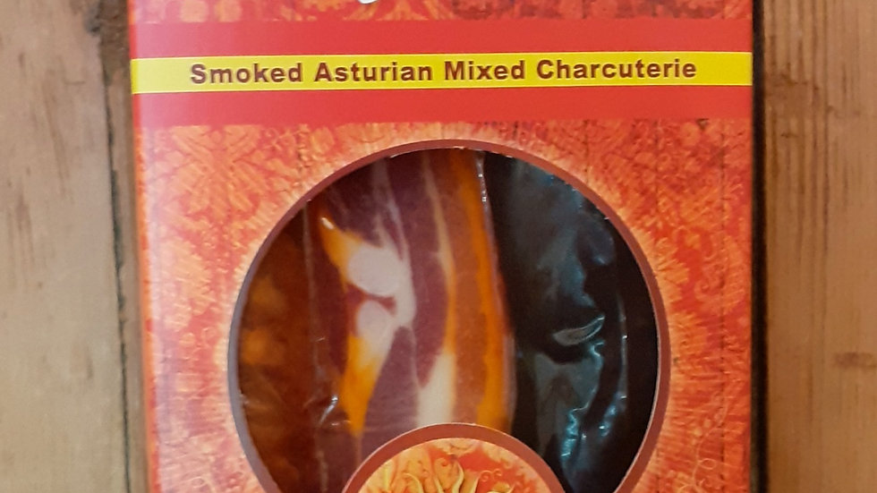 a cardboard pack of asturias asturian charcuterie meats chorizo panceta morcilla for adobada stew on a wooden shelf