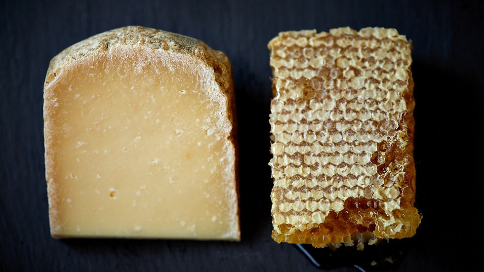Hard Raw Milk Rinded Sheep's Milk Cheese Raw Ewe's Milk British Cheese Honeycomb Dripping with honey