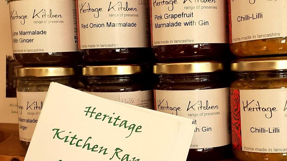 Handmade pickle chutney preserve jam jars on wooden shelf