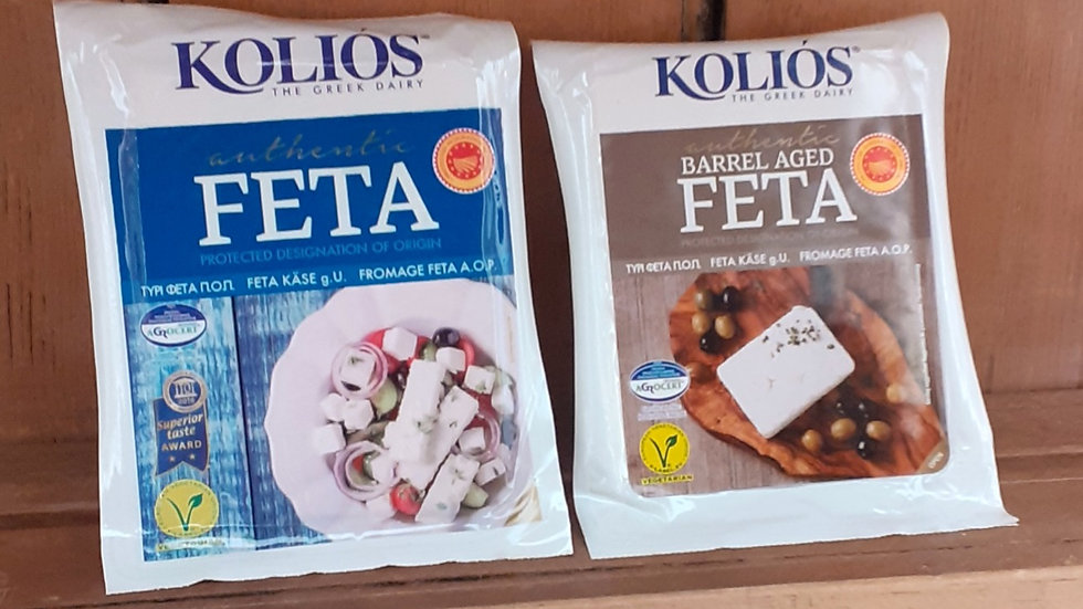 two packs of greek feta cheese on a wooden shelf