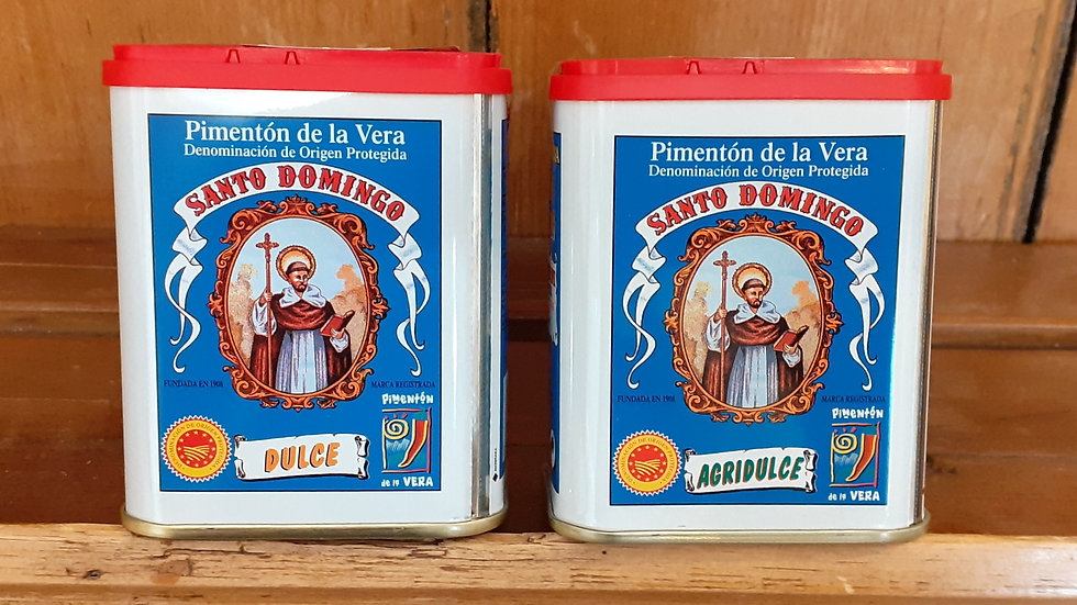 traditional tins of spanish smoked paprika pimenton on a wooden shelf