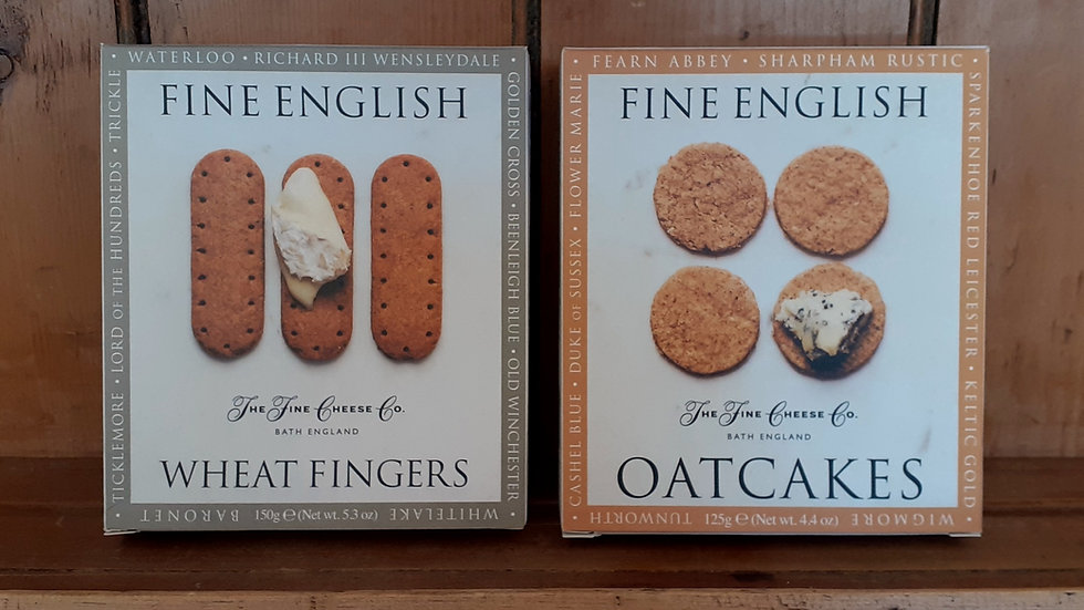 Cardboard boxes of fine english biscuits for cheese on a wooden shelf