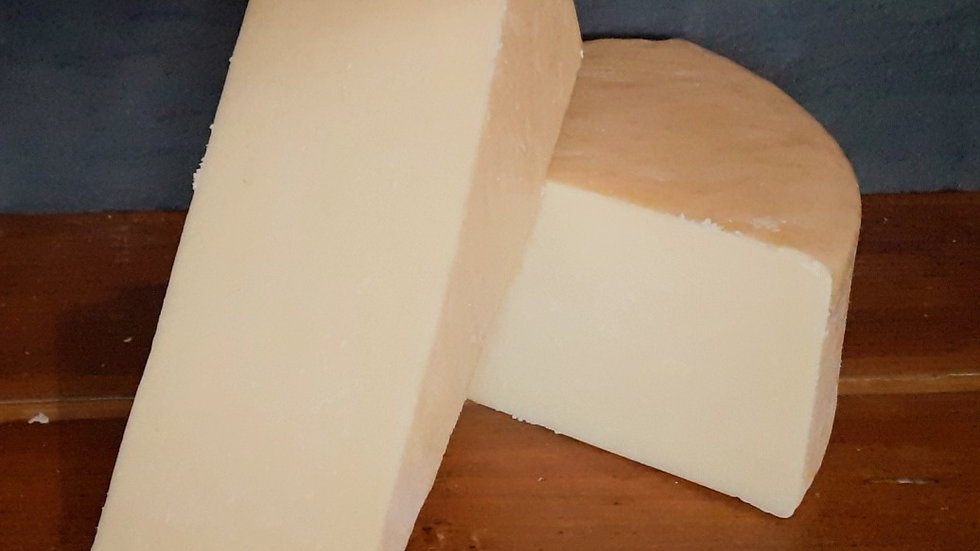 Cut Pieces of Traditional English Wookey Hole Cheddar Cheese Yellow Hard Cheese