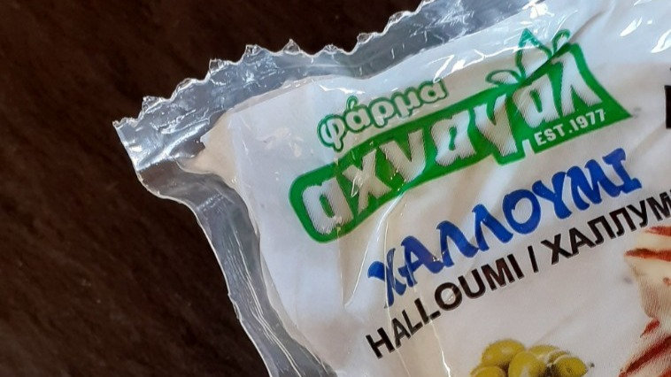 Cypriot Halloumi Cheese in Vacuum Pack Plastic Pack Greek Text Cheese Grilling