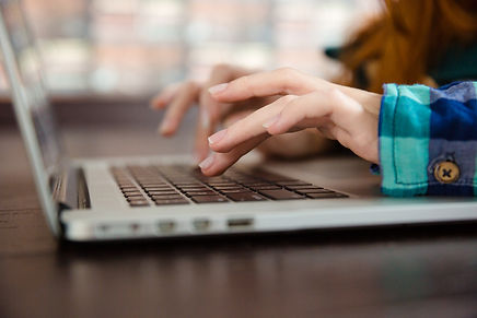 hands-of-young-woman-typing-using-laptop