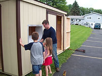 installing St. Pauly Used Clothing Shed