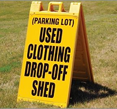 yellow used clothing drop off sign