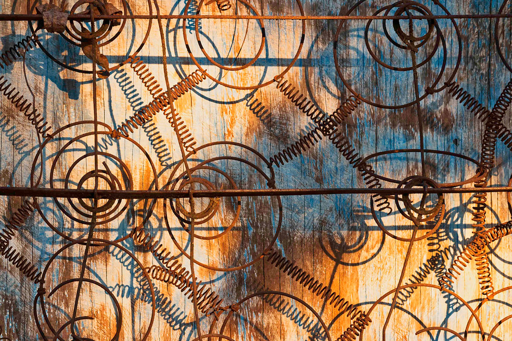 rusted metal springs and wood