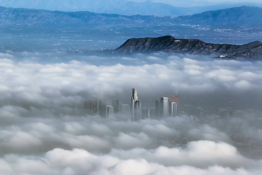 Los Angeles skyscrapers emerging from the clouds