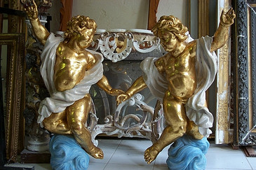 Angelots en bois sculpté