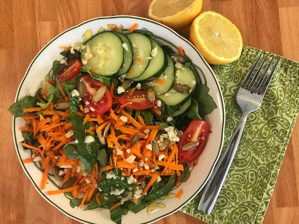 Seasonal Greens Salad with a tangy lemon garlic dressing