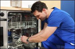 man working on dishwasher repair