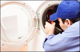 repairman working on washing machine repair