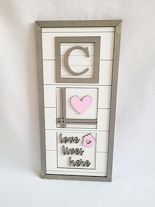 Monogram  leaning sign love lives here