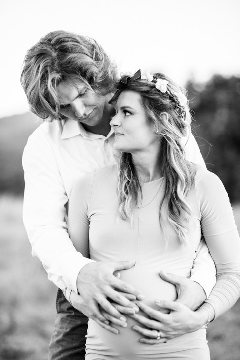 Black and white picture of husband holding wife in