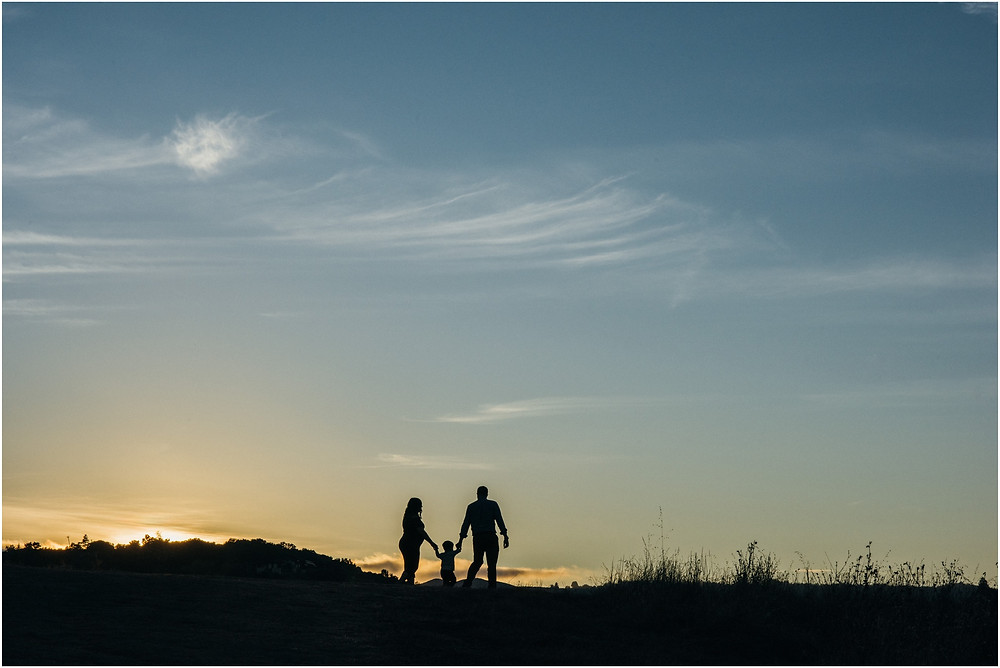 Silhouette shot of a family of three in Bay Area
