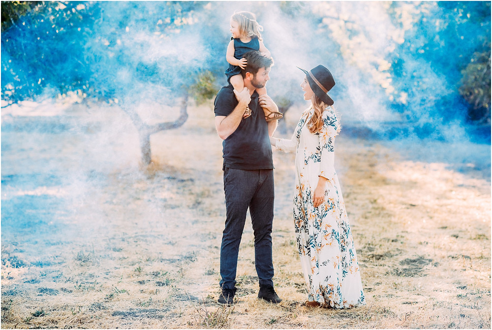 Smoke bomb gender reveal in open field in San Jose