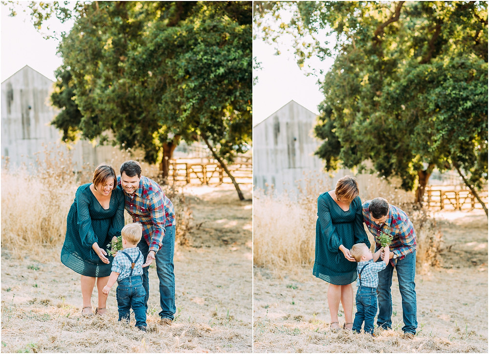 Family in front of white rustic barn for pictures in San Jose, ca