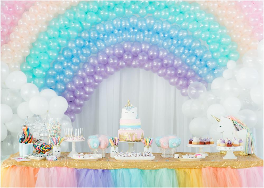 Unicorn birthday party with unicorn cake