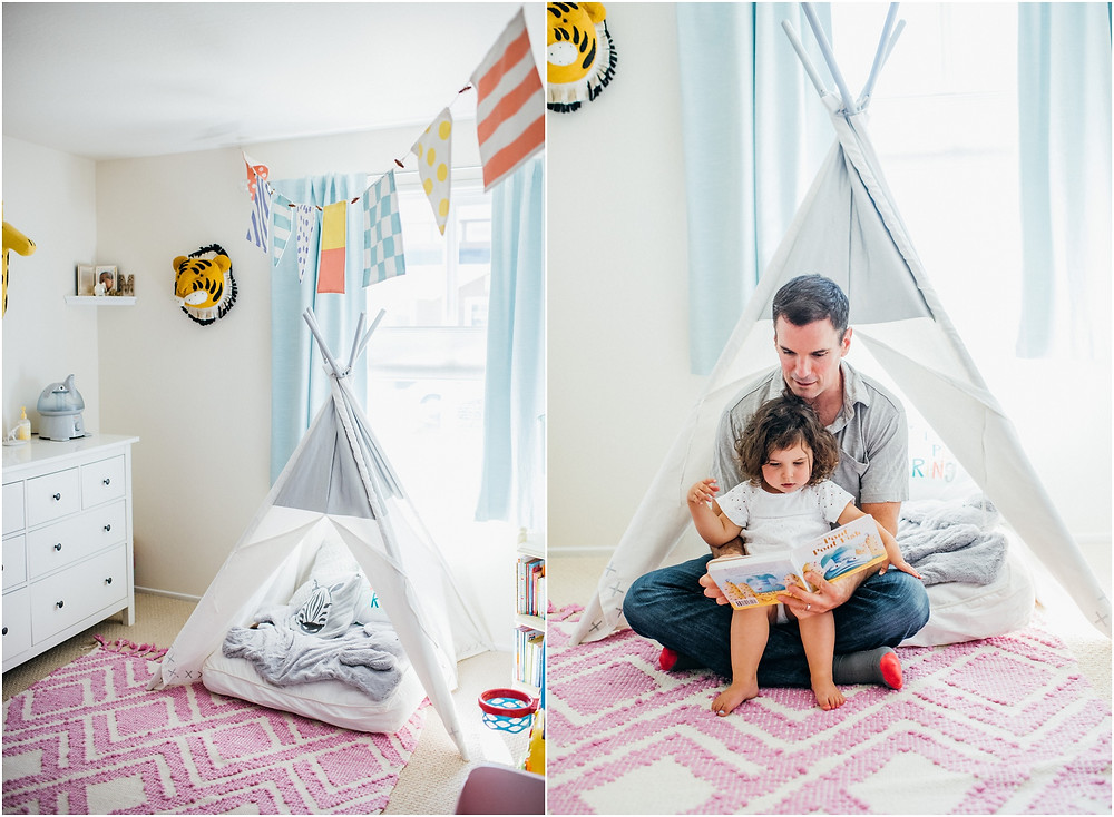 Dad reading to daughter in a teepee from Pottery Barn
