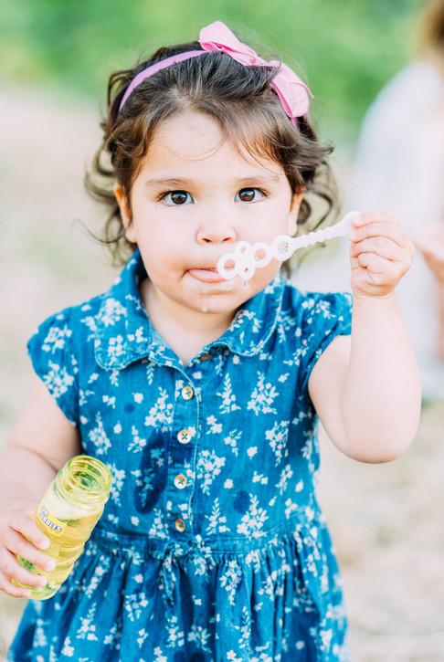 Little girl blowing bubbles in San Jose