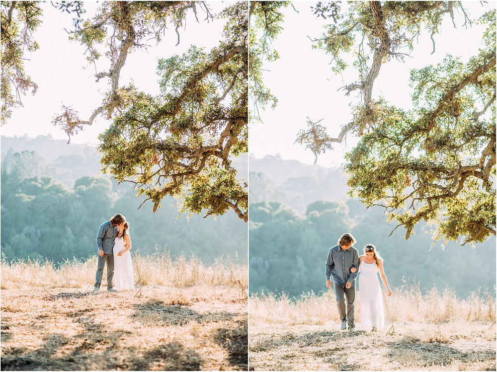 Couple kissing under oak tree for their maternity session in San Jose, Ca
