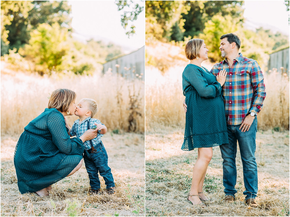 Little boy kissing his mom in front of rustic barn for maternity pictures in Bay Area