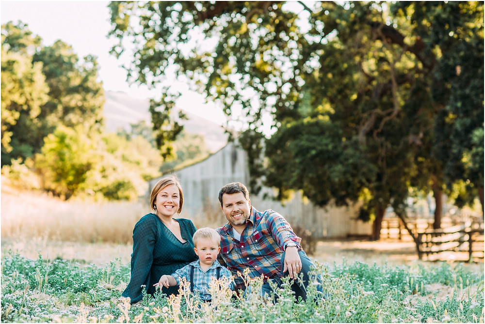 Family in front of Bay Area barn for maternity photographer