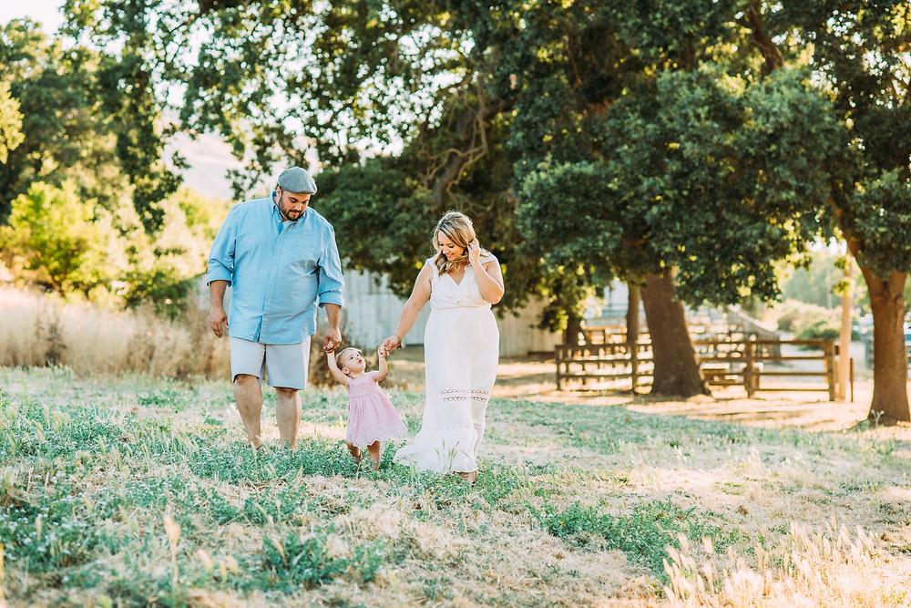 Family walking in front of barn in San Jose