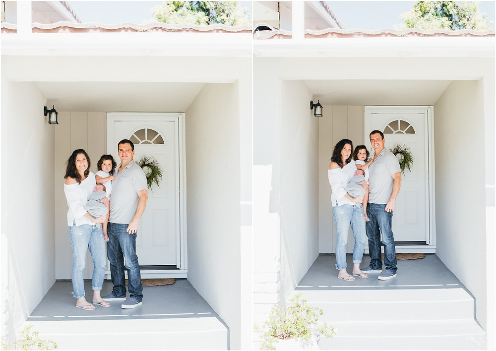 Family in front of their front door in Corte Madera for newborn photography