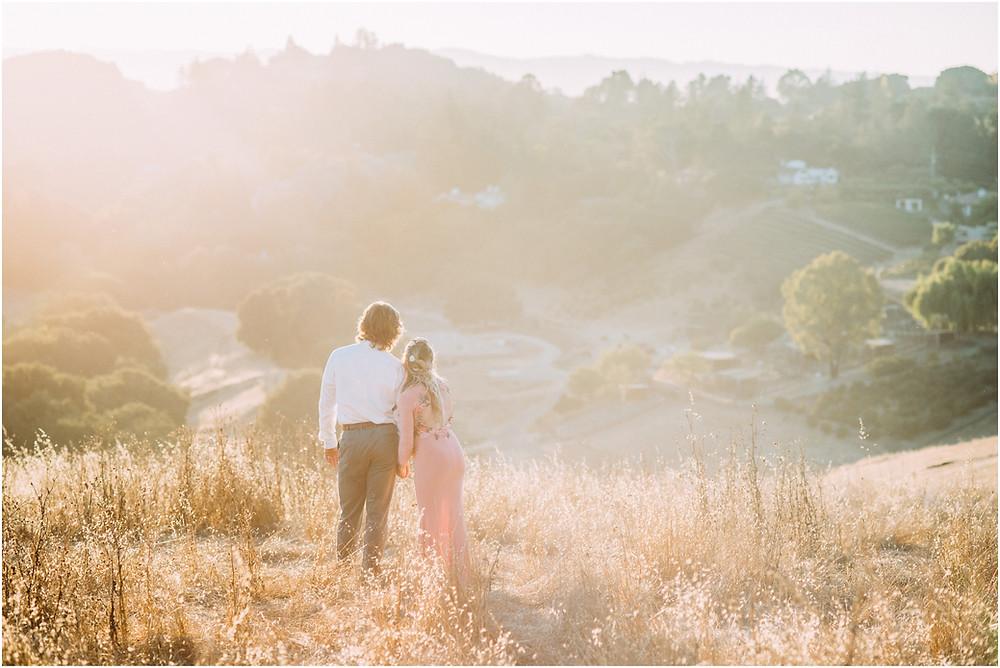 Couple overlooking mountain range in Los Altos, Ca